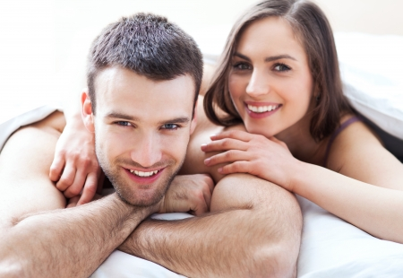 Young couple in bed photo