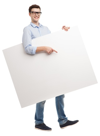 Young man with blank whiteboard photo