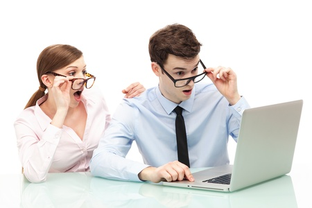 Shocked couple in front of laptop photo
