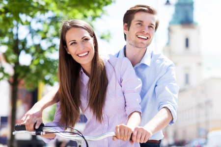 Young couple on bike photo