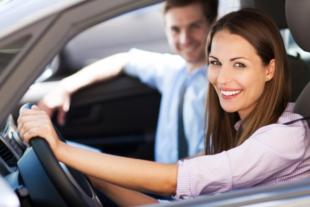 driving: Young couple sitting in car