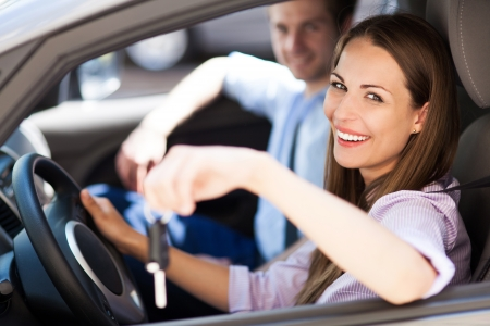 car driver: Young woman showing car keys