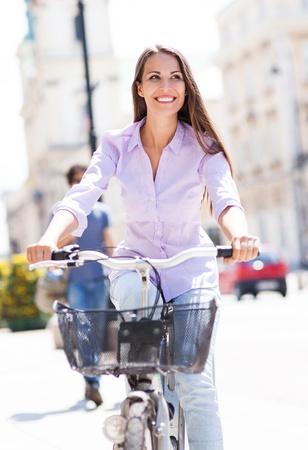 city bike: Woman riding a bike in the city