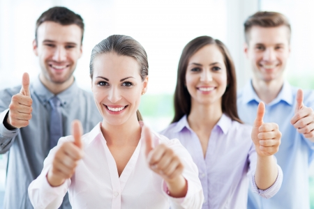 Business team with thumbs up photo