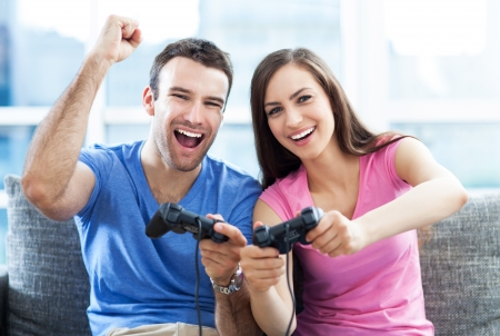 Couple playing video games Imagens