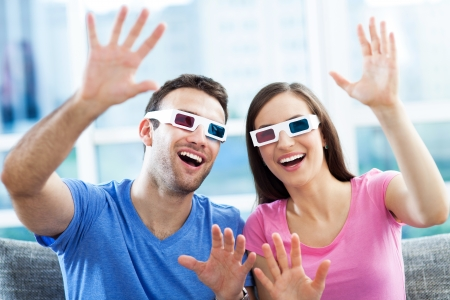 Couple wearing 3d glasses photo