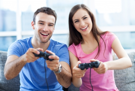 game room: Couple playing video games Stock Photo