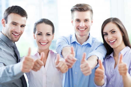 Coworkers showing thumbs up photo