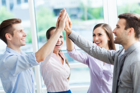 huddle: Business group joining hands Stock Photo