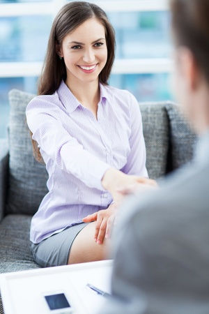 JOB INTERVIEW: Young woman in Job interview  Stock Photo