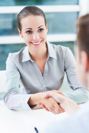 Businesswoman shaking hands photo