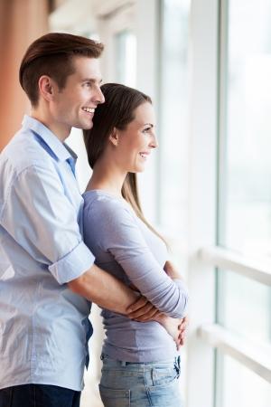 Couple looking through window photo