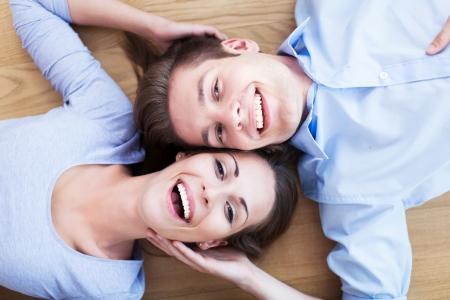 enjoying life: Couple lying on the floor Stock Photo