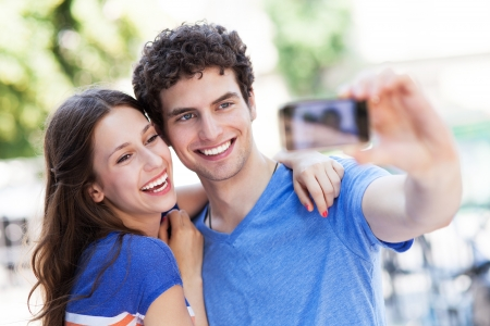 Couple taking photo of themselves  photo