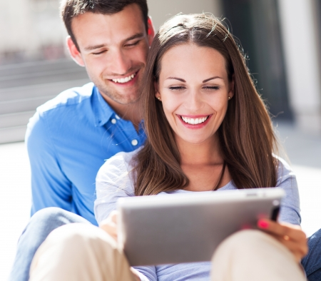 Young couple with digital tablet photo