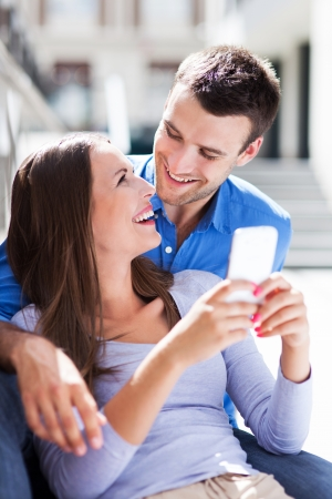Couple with mobile phone Stock Photo - 21331449