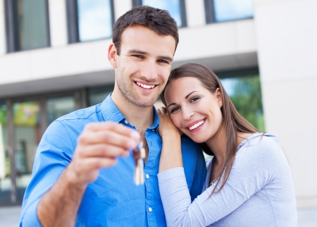 Couple with keys to new home Stock Photo - 21331453