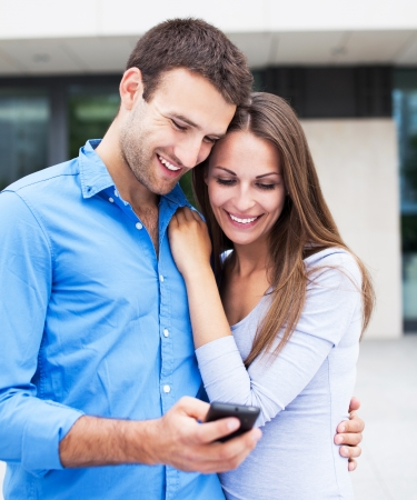 Couple with mobile phone Stock Photo - 21325336