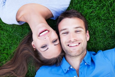 lying on grass: Couple lying on grass  Stock Photo