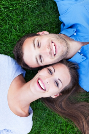 Couple lying on grass  photo