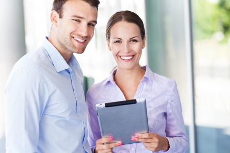 Business people with digital tablet photo