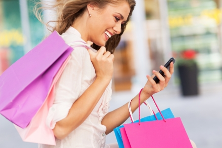 mobile: Attractive woman shopping Stock Photo