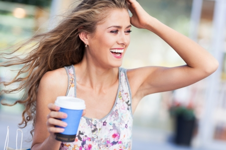 to go cup: Woman outdoors with coffee