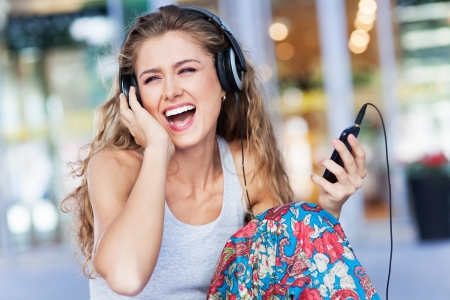 Young woman enjoying music photo