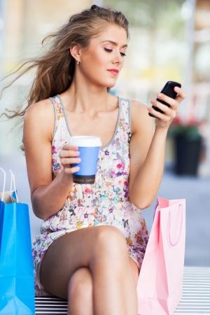 having a break: Woman having a break from shopping