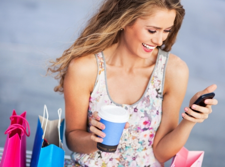Woman having a break from shopping photo
