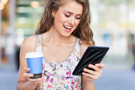 e book reader: Woman with digital tablet and coffee