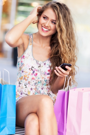 Shopping woman text messaging photo