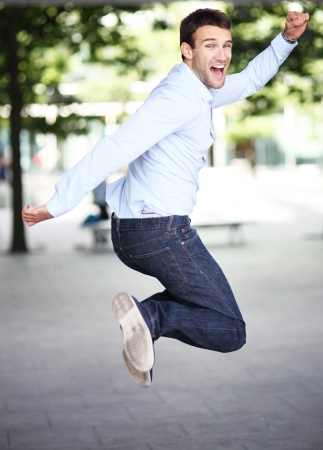 Man jumping with joy photo