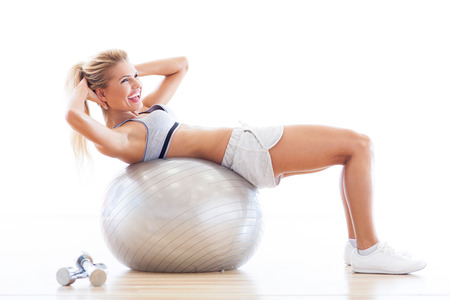 Woman lying on fitness ball photo