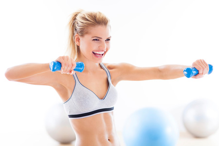 Woman working out with dumbbells photo
