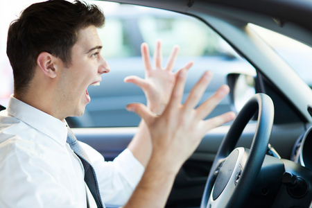 troubles: Frustrated man driving car