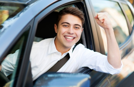 Excited man driving a car photo