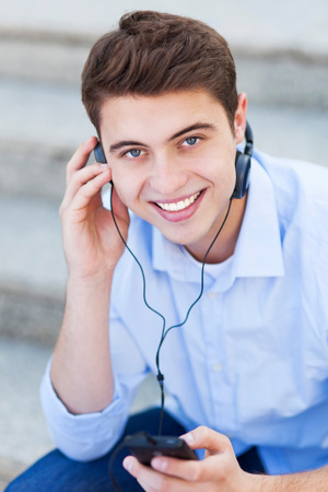 Young man listening to music photo