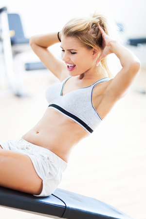 Woman exercising in a gym photo