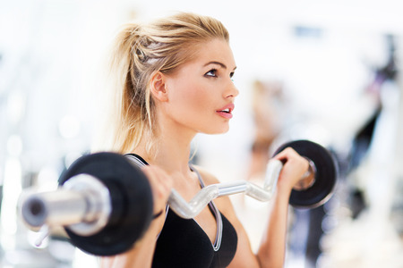 woman lifting weights: Woman Lifting Weights