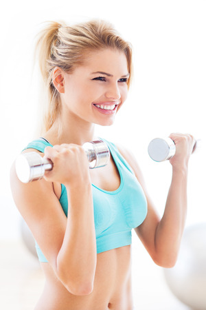 Woman working out with dumbbells Stock Photo - 23454221