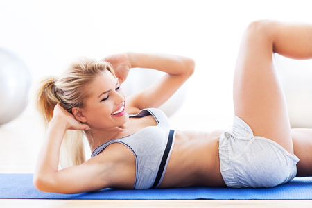 Woman doing sit-ups photo