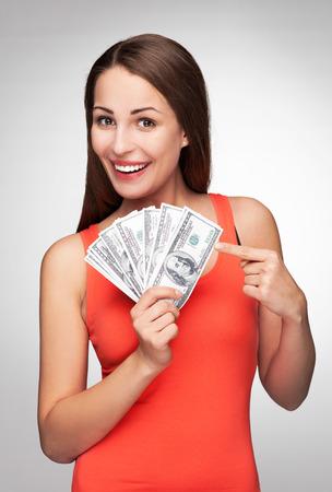 pont: Nő, kezében dollár számlák Stock fotó