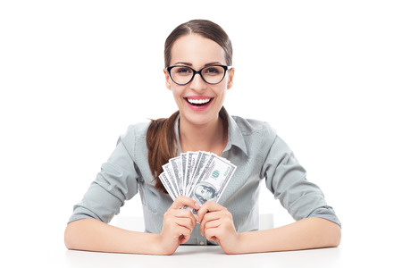 wages: Young businesswoman holding money