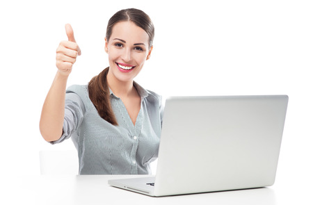 Woman with laptop showing thumbs up photo