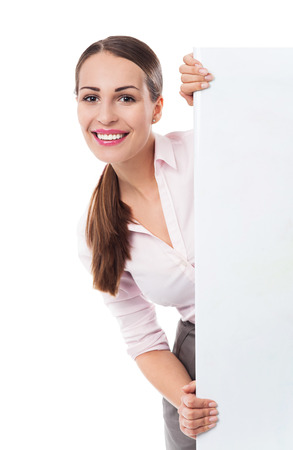 Young woman holding blank poster photo