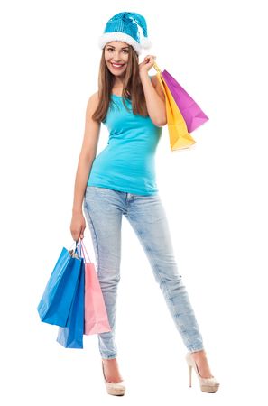 shoppings: Woman carrying bags with christmas shoppings
