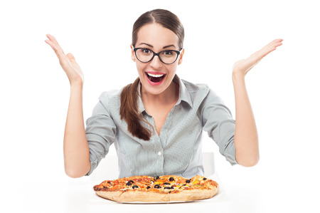 Happy woman eating pizza photo