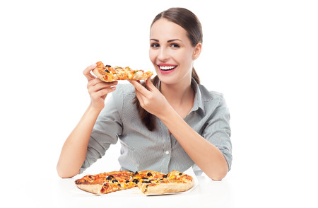 Woman eating pizza photo