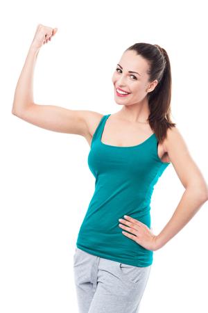 Woman flexing biceps photo